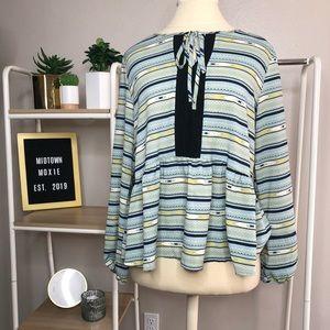Collective Concepts size M blouse
